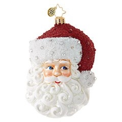 This St. Nick enchants with gleaming silver accents and jewels sprinkled about his cap and curly white beard.