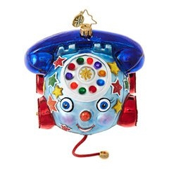 Here's truly unusual take on the mobile phone! This one is a multicolored, pullable model on wheels with a cute face and old time rotary dial styling.