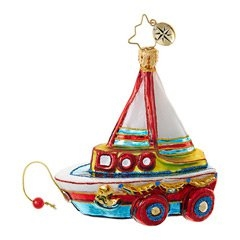 A toy boat on wheels makes for a nautically Merry Christmas! It's a totally see-worthy ornament with its beautifully hand-painted red, white, blue and gold design.