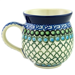 "Pattern Designed By Teresa Liana.  The artist has been connected with the Artistic Handicraft Cooperative ""Artistic Ceramics and Pottery"" since 1983. Since 1992 she has been a pattern designer.  Unikat pattern U72."
