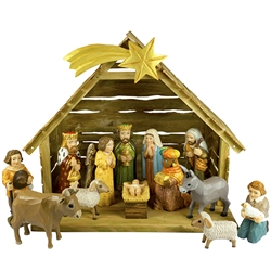 "The Holy Family and in particular the Nativity is a popular theme in Polish folk art. Composed of a natural wood creche  and all hand painted wooden pieces. Tallest figure is approx 6.25"" tall. This is the work of folk artist Piotr Wolinski and highly"