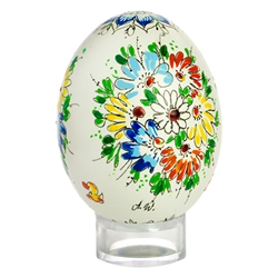 This beautifully designed chicken egg is hand painted by master folk artist Alina Wypchlo from Opole, Poland. Her colors are strong and bright. Look carefully and you will find humorous folk elements of nature incorporated into her designs (i.e. a cricket
