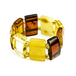 "Delightful slices of natural amber connected by a double strand of of woven stretch material and separated with beads. Rings start at size 5 and stretch to fit the largest fingers.  Amber size varies from .3 to .4"" high."