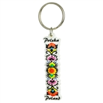 Attractive rubber key chain featuring a beautiful Lowicz floral pattern.