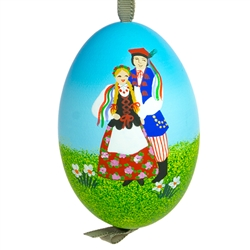 This beautiful hand painted goose egg comes ready to hang. The eggs have been emptied and strung through with ribbon for hanging. No two eggs are exactly alike and ribbon colors vary as well. Signed by the artist.