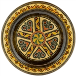 This Polish plate is made from beech wood in the mountain region of southern Poland called Podhale.  The plates are cut and shaped on a lathe by hand.  The floral designs are burned into the wood then painted after staining and varnishing.  All the flower