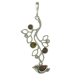 "Artistic silver work highlighted with Baltic amber.  Size approx 2"" x 1""."