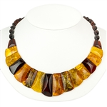 This stylish amber necklace features shades of yellow, honey, and cherry amber. The beads are slightly hexagonal in shape and slightly faceted.