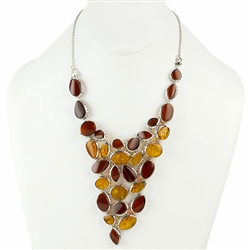 Elegantly designed cluster of interlocking amber cabachons each framed in silver create one stunning necklace (in our opinion).