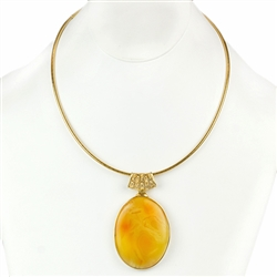 "Beautiful custard amber cabochon suspended on a 24k gold vermeil slide necklace and held in a 24k gold vermeil frame.  Necklace is 17.5"" long"