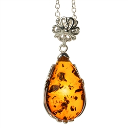"Beautiful sterling silver pendant and adjustable length chain (18"" long max.).  Sterling silver filigree like frame around this beautiful piece of amber."