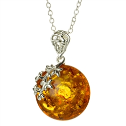 "Beautiful sterling silver pendant and adjustable length chain (18"" long max.) decorating an oval amber cabochon.  Can be worn on either side."