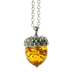 "Beautiful sterling silver pendant and adjustable length chain (18"" long max.) with honey amber in the shape of an acorn."