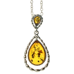 "Beautiful sterling silver pendant and adjustable length chain (18"" long max.) featuring two teardrop shaped amber cabochons in honey and green color."