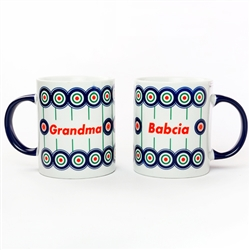 This attractive ceramic mug is decorated in a Boleslawiec motif.