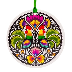 Folk art is the perfect souvenir from Poland. This ornament is inspired by the paper cuts from the Lowicz area of central Poland.
