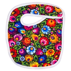 100% cotton baby's bib in a traditional Polish Lowicz flower design. Metal snap opener.