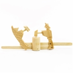 This is a traditional Polish folk toy made of unfinished Linden wood from the Tatry mountain region in southern Poland.  Push and pull to make the farmer and bear beat down on the block. 