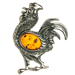 "Our Polish sterling silver rooster is highlighted with a nice oval amber cabochon.  Rooster size approx 1.75"" x 1.5""."