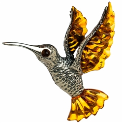"Our beautiful hummingbird is approx 2"" x 2"".  Silver with amber.  Shades can vary slightly."