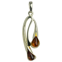 Drop of honey amber wrapped in silver in a calla lily shape.  Stylish and unique.