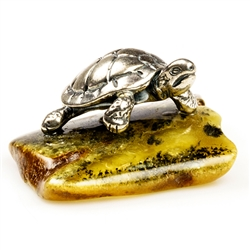 "Our small sterling silver turtle has just landed on an natural amber ledge. Hand crafted. Size approx 1"" x 1.25"" x .6"""