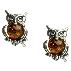 Charming sterling silver owl earrings with honey amber tummy.