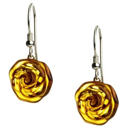 Nicely detailed rose carved into amber with a sterling silver backing.