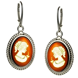 Incredibly beautiful silhouettes carved into Baltic honey amber, set in sterling silver, with hook and lever safety clasp.