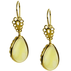 Custard amber teardrop earrings set in gold vermeil. Amber is soft, only slightly harder than talc, and should be treated with care.