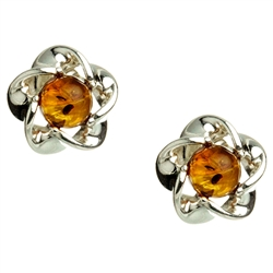 Gorgeous Baltic Amber round stud earrings surrounded with a star shaped Sterling Silver setting.