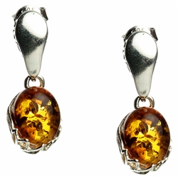 Gorgeous Baltic Amber oval stud earrings surrounded with a ring of Sterling Silver filigree work.