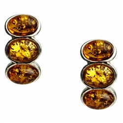 "Three oval shaped amber cabochons set in silver with post backs.  Size approx .75"" x .4"""