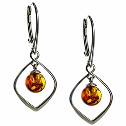 Honey amber drops suspended in sterling silver. Stylish and unique.