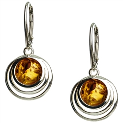 Honey amber balls wrapped in sterling silver circles.