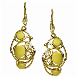 Stylish and unique.  Custard amber in a setting of gold vermeil wire and studded with a cubic zirconia.