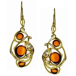 Stylish and unique.  Cherry amber in a setting of gold vermeil wire and studded with a cubic zirconia.