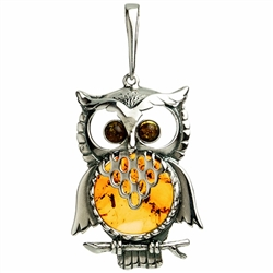 "Our Polish sterling silver owl is highlighted with a nice round amber cabochon. Rooster size approx 2"" x 1""."