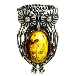 "Our Polish sterling silver owl is highlighted with a nice oval amber cabochon. Size approx 1"" x .75""."