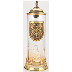This unique glass stein has an antiqued bronze colored metal lid, thumblift, and base. The base of the glass features a permanent amber spray color. The center of the glass stein is decorated with an antiqued bronze colored medallion that reads POLSKA and