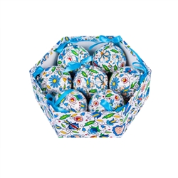 Folk art is the perfect souvenir from Poland. This ornament set is inspired by the flower designs of the Kashub region of northwest Poland. Lightweight, unbreakable plastic with a decorative Kashub floral pattern. Each ornament comes with a blue ribbon