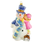 "This beautiful ornament of a snowman getting the final touches on his dress up is just precious. Highly detailed. Size approx. 6.5"" x 3.5"" x 2.5"". Made In Poland."