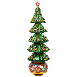 "This beautifully decorated wooden tree is hand painted in Russia. Winding the cathedral clockwise plays the popular Russian melody, ""Midnight In Moscow"". Tree top star is removable for shipping."
