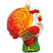 Cock-a-doodle-doo! Rise and shine on Christmas morn to the alluring call of this beautiful glass rooster! With chest puffed out and tail held high, our king of the henhouse struts his stuff for all to admire his shimmering glass form. Expertly crafted in