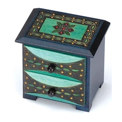 Two drawer chest with border design on the top accented with metal inlay.