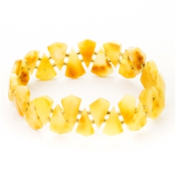 "Custard amber slices with beads between each piece.  Size approx 2.25"" diameter before stretch.  Approx .75"" wide.  Shades of amber will vary from bracelet to bracelet."