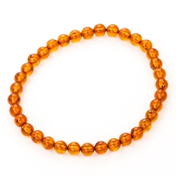 "Beautiful round cognac amber beads on elastic band. Size approx 2.25"" diameter.  Bead size approx 4mm."