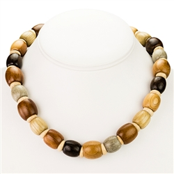 Beautiful handmade hazelnut wood necklace. The hazelnut wood is very light and is nicely polished.  Made In Poland.