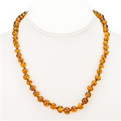 "Golden honey amber beads, rounded and knotted between each bead. Gold vermeil clasp. Bead size varies from .25"" to .37"" wide."