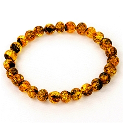 Beautifully shaped round amber beads speckled with lots of inclusions.